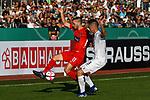 10.08.2019, Donaustadion, Ulm, GER, DFB Pokal, SSV Ulm 1846 Fussball vs 1. FC Heidenheim, <br /> DFL REGULATIONS PROHIBIT ANY USE OF PHOTOGRAPHS AS IMAGE SEQUENCES AND/OR QUASI-VIDEO, <br /> im Bild Michael Schindele (Ulm, #3), Robert Leipertz (Heidenheim, #13) mit einem Hackentrick<br /> <br /> Foto © nordphoto / Hafner