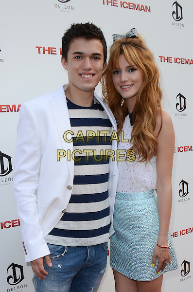 Remy Thorne, Bella Thorne.The premiere of 'The Iceman' at ArcLight Hollywood, Hollywood, California, USA..April 22nd 2013.half length blue skirt white top stripe top suit jacket brother sister siblings family .CAP/ADM/TW.©Tonya Wise/AdMedia/Capital Pictures.