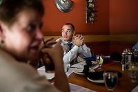 Nick Culbertson (center), of Dunellen, New Jersey, celebrates with family at lunch at Legal Seafoods in Boston, Massachusetts, after his graduation from Harvard University on May 26, 2011.  Also pictured, at left, is Culbertson's grandmother Lillian Culbertson.<br /> <br /> Photo: M. Scott Brauer for the Star-Ledger