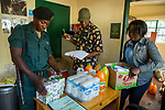 Anti-poaching scout receiving supplies for deployment, Kafue National Park, Zambia