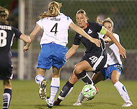 Abby Wambach #20 of the Washington Freedom gets caught between Stacy Bishop #4 and Sue Weber #20 of the Boston Breakers during a WPS match at the Maryland Soccerplex, in Boyd's, Maryland, on April 18 2009. Breakers won the match 3-1.