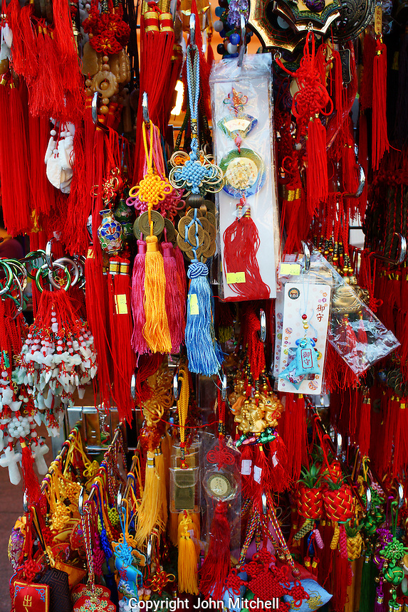 Chinese good luck charms for sale at the night market in Chinatown, British Columbia, Canada