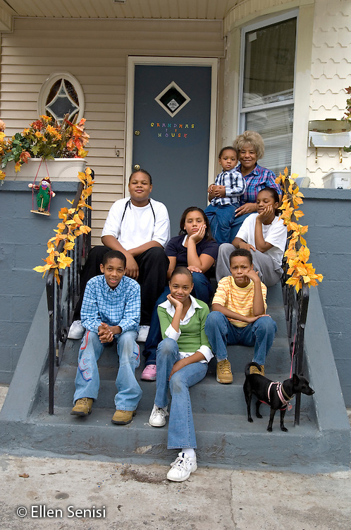 MR / Schenectady, NY.Grandmother-headed family portrait. Foster children, adopted children and grand children all (African-American) with woman (Adoptive mother, Foster mother, African-American) in their home. Childrens ages range from 2 to 14. Woman has had 55 foster children over a thirty year period and has adopted 3 of them..MR: AG-gsf.© Ellen B. Senisi