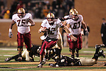 4 November 2006: Boston College quarterback Matt Ryan (12) avoids the Wake Forest defender for a first down run. Wake Forest defeated Boston College 21-14 at Groves Stadium in Winston-Salem, North Carolina in an Atlantic Coast Conference college football game.