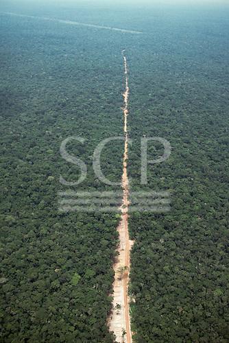 Juruena, Mato Grosso, Brazil. Aerial view of new dirt road penetrating virgin rainforest in a straight line.