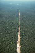 Juruena, Mato Grosso, Brazil. Aerial view of new dirt road penetrating virgin rainforest in a straight line.