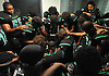 The Wyandanch varsity football team gathers in the locker room before a Division IV game against Center Moriches at Wyandanch High School on Thursday, Sept. 7, 2017.