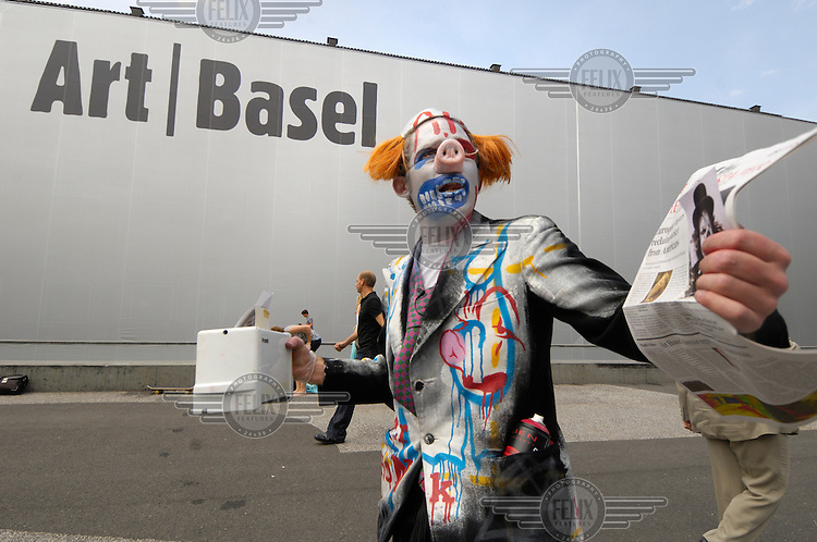 An artist in performance outside the main hall of Art Basel, the world's most important contemporary art fair. Over three hundred galleries from 30 countries and buyers from all over the world attended the show.