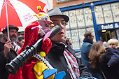 Covent Garden, London, UK. 11 May 2014. The festival starts with a procession around the streets of Covent Garden. Puppeteer with a puppet. The Covent Garden May Fayre and Puppet Festival takes place at St Paul's Church.