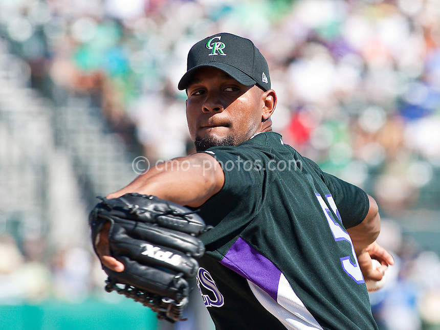 Mar 17, 2009; Tucson, AZ, USA; Colorado Rockies pitcher Juan Morillo pulls the ball out of his globe while warming up in the bullpen during a spring training game against the Kansas City Royals at Hi Corbett Field.  The Royals and the Rockies tied 9-9 after 10 innings.