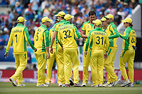 The Australians get together following the wicket of Shikhar Dhawan (India) during India vs Australia, ICC World Cup Cricket at The Oval on 9th June 2019