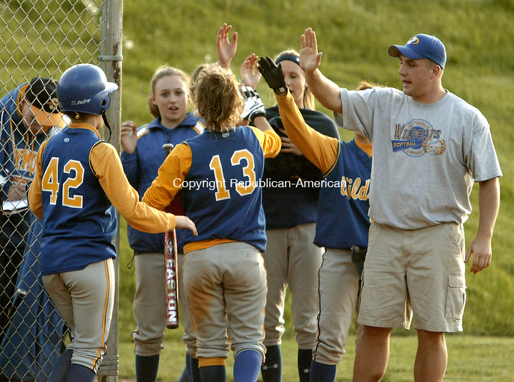 SEYMOUR, CT- 19 MAY 2005-051905JS03--Seymour's Erin Haggerty (13) receives congratulations from teammates and coaches after scoring on a sacrifice fly by Becky Stochmal (42) during their NVL game against Naugatuck at Matthies Park in Seymour on Thursday.   --- Jim Shannon Photo--Naugatuck; Seymour; Erin Haggerty; Becky Stochmal are CQ