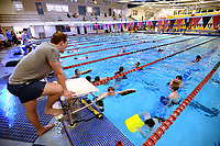 Dawson Layman, head development coach for the AquaHawgs swim team, directs swimmers Thursday, Jan. 9, 2020, during practice at the Jones Center in Springdale. About 120 members of the team practice at the pool in three shifts because of a lack of indoor public pools in Northwest Arkansas. Check out nwaonline.com/200112Daily/ for today's photo gallery.<br /> (NWA Democrat-Gazette/Andy Shupe)