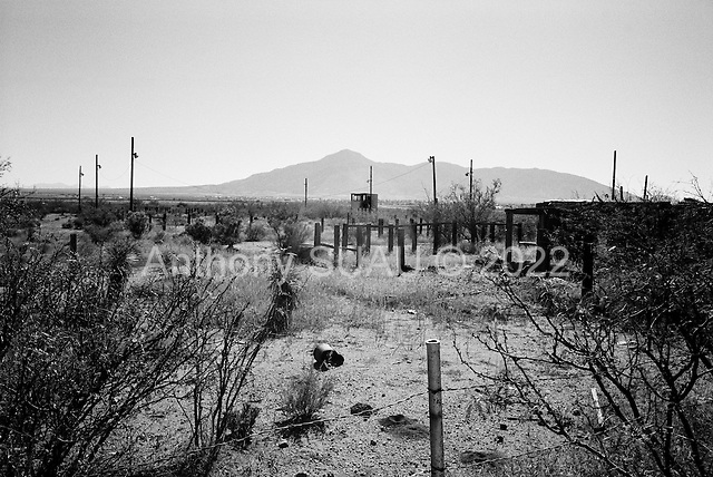 near Douglas, Arizona.USA.October 21, 2006..Abandoned fields and houses near the Mexican border. Many homes, buildings and fields are vacant and abandoned near the border as thousands of illegal immigrants pass through these areas at night led by Cayotes, highly paid guides from Mexico that know the terrain very well.