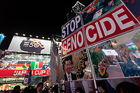 A Young people hold banners calling for the end to Genocide in China at a  rally in support of protestors in Hong Kong in Hachiko Square, Shibuya, Tokyo, Japan. Saturday November 16th 2019