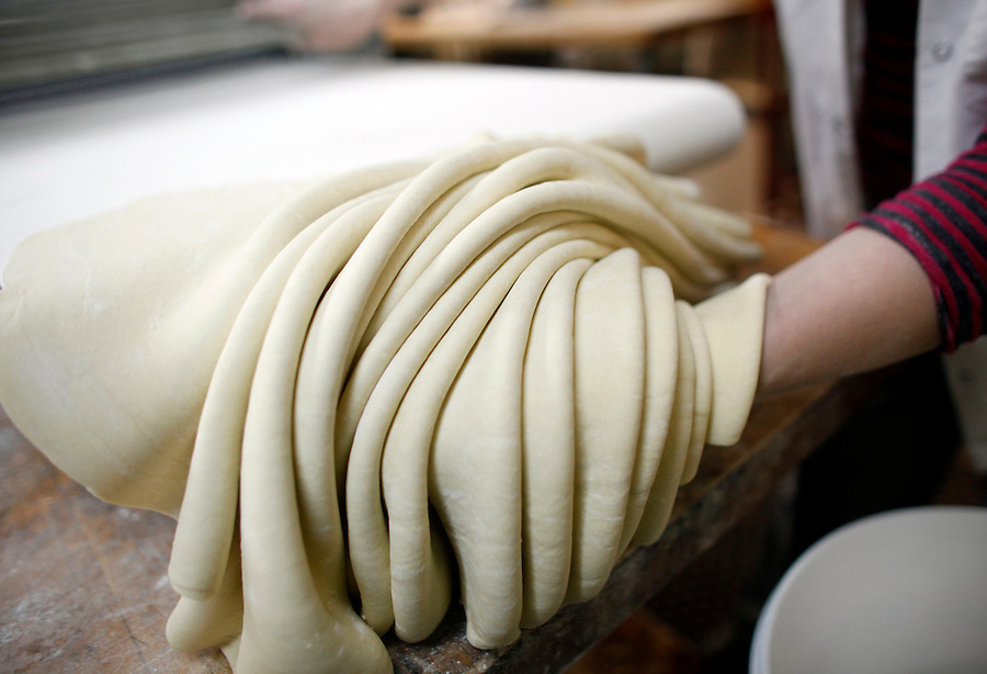 30090176A..Dough is prepared at Ukrainian restaurant Vesleka to make special dumplings (vushka) which are served in borscht as part of the traditional Ukrainian Christmas Eve dinner....Photo by Natalie Behring for the New York Times
