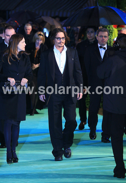 **ALL ROUND PICTURES FROM SOLARPIX.COM**.**WORLDWIDE SYNDICATION RIGHTS**.Outside arrivals at the World Premiere of Alice in Wonderland.  Held at The Odeon, Leicester Square, London, UK. 25 February 2010...This pic: Johnny Depp..JOB REF:10800 LNJ     DATE: 25_02_2010.**MUST CREDIT SOLARPIX.COM OR DOUBLE FEE WILL BE CHARGED**.**MUST NOTIFY SOLARPIX OF ONLINE USAGE**.**CALL US ON: +34 952 811 768 or LOW RATE FROM UK 0844 617 7637**