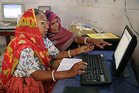 Norti (foreground), is a dalit (untouchable caste) and a semi-literate villager who now runs the Barefoot CollegeÕs computer program that helps train other village women in computer skills...