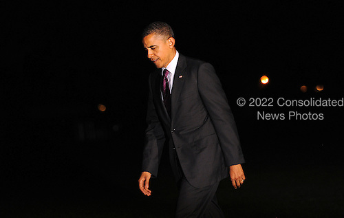 United States President Barack Obama walks on the South Lawn of the White House as he returns from Florida, June 22, 2012  in Washington, DC. .Credit: Olivier Douliery / Pool via CNP