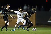 WINSTON-SALEM, NC - DECEMBER 01: Machop Chol #21 of Wake Forest University is fouled by Jack Hallahan #11 of the University of Michigan during a game between Michigan and Wake Forest at W. Dennie Spry Stadium on December 01, 2019 in Winston-Salem, North Carolina.