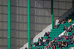 Home fans enjoying some sunshine in the East Stand at Easter Road stadium during the first-half of the Scottish Championship match between Hibernian and visitors Alloa Athletic. The home team won the game by 3-0, watched by a crowd of 7,774. It was the Edinburgh club's second season in the second tier of Scottish football following their relegation from the Premiership in 2013-14.