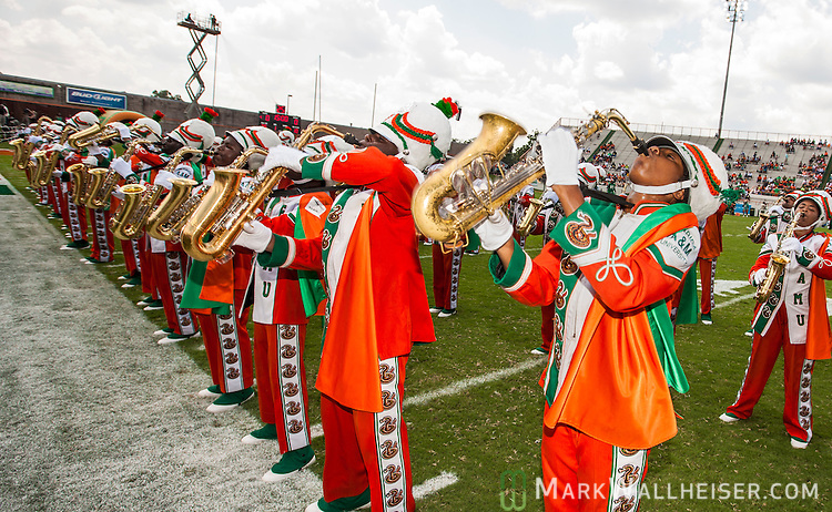 TALLAHASSEE, FL - SEPTEMBER 7, 2013:   <br /> Tthe FAMU Marching 100 band perform on the field prior to FAMU's NCAA football game against the Tennessee State Tigers.   The temperature was 110 degrees on the filed.