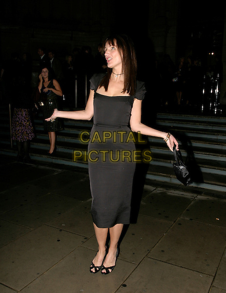 SAFFRON ALDRIDGE.British Fashion Awards, Raphael Gallery, Victoria & Albert Museum, London, SW7, UK,.November 10th, 2005.Ref: AH.full length black dress arms hands.www.capitalpictures.com.sales@capitalpictures.com.© Capital Pictures.