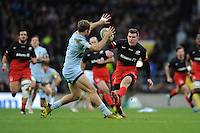 Ben Spencer of Saracens chips over the head of Chris Pennell of Worcester Warriors during the Premiership Rugby match between Saracens and Worcester Warriors - 28/11/2015 - Twickenham Stadium, London<br /> Mandatory Credit: Rob Munro/Stewart Communications