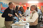 United States President Barack Obama and family serve Thanksgiving meals to homeless and at-risk veterans at the Friendship Place homeless center in the basement of St. Luke's Methodist Church, in Washington, DC, Wednesday, November 25, 2015.  As part of the Administration's focus on reducing the rate of veteran homelessness, Friendship Place received a $3.1 million grant from the Department of Veterans Affairs in 2015.  From left to right: President Obama, Malia Obama, first lady Michelle Obama, Sasha Obama.<br /> Credit: Martin H. Simon / Pool via CNP