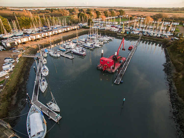 Aerial view of the yacht harbour at Emsworth marina in West Sussex at dusk.