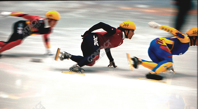 American short track speed skater Apolo Anton Ohno takes a turn during the men's 1000m heats at the Delta Center.
