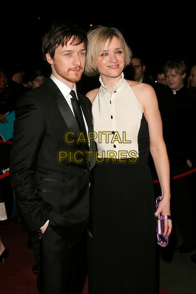 JAMES McAVOY & ANNE-MARIE DUFF.The Orange British Academy Film Awards in 2008 The Royal Opera House, Covent Garden, London, England. .February 10th, 2008 .BAFTA Arts half length black suit white dress couple hand in pocket clutch bag purse beard facial hair.CAP/AH.©Adam Houghton/Capital Pictures