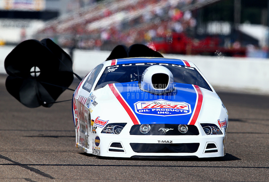 Aug. 17, 2013; Brainerd, MN, USA: NHRA pro stock driver Larry Morgan during qualifying for the Lucas Oil Nationals at Brainerd International Raceway. Mandatory Credit: Mark J. Rebilas-