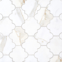 Andre, a stone waterjet mosaic, show in polished Calacatta Gold, is part of the Semplice™ collection for New Ravenna.