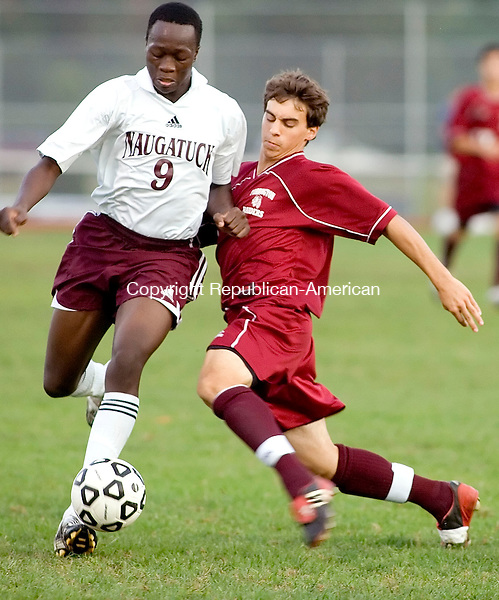 NAUGATUCK, CT- 03 OCT 2007- 100307JT09- <br /> Torrington's Michael Parrotta tries to steal the ball from Naugatuck's Emanuel Nanadoum during Wednesday's game at Naugatuck, which ended 1-1 after overtime.<br /> Josalee Thrift / Republican-American