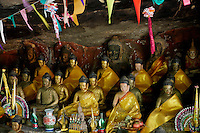 Small ceremony cave temple with Buddha statues in the Phnom Kulen area, Cambodia