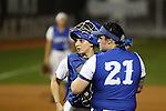 CHAPEL HILL, NC - FEBRUARY 24: Hampton's Sarah Kallas (behind) talks to Allyson Babinsack (21) in the circle. The Hampton University Pirates played the Towson University Tigers on February, 24, 2017, at Anderson Softball Stadium in Chapel Hill, NC in a Division I College Softball match. Towson won 17-2 in a five inning run-rule game.