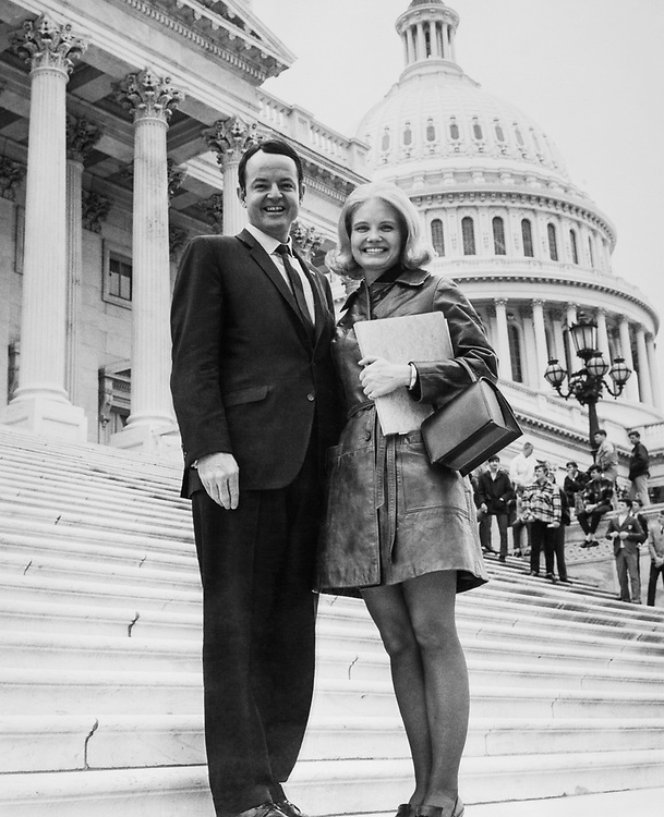 Rep. John T. Myers, R-Ind., and a pretty constituent at Capitol Hill. (Photo by CQ Roll Call)