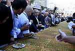 Palestinian prime minister Salam Fayad eat from the biggest dish of traditional sweets Konafa into the Guinness Book of Records in the West Bank city of Nablus on July 18 2009. Photo by Issam Rimawi