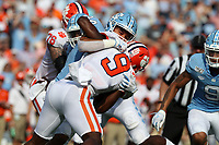 CHAPEL HILL, NC - SEPTEMBER 28: Travis Etienne #9 of Clemson University is tackled by Jeremiah Gemmel #44 of the University of North Carolina during a game between Clemson University and University of North Carolina at Kenan Memorial Stadium on September 28, 2019 in Chapel Hill, North Carolina.