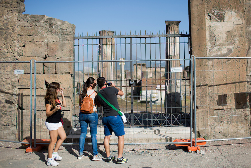 Tourists make their way into the Pompeii, Italy ruins on Friday, Sept. 18, 2015. The city of Pompeii was destroyed when nearby Mount Vesuvius erupted on August 24, AD 79. The town and its residents were buried and forgotten until the ruins were discovered and eventually excavated hundreds of years later. The ruins are one of Italy's top tourist attractions today. (Photo by James Brosher)