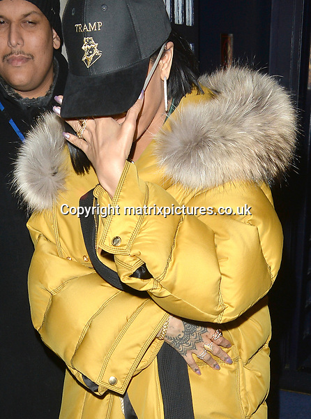 NON EXCLUSIVE PICTURE: MATRIXPICTURES.CO.UK<br /> PLEASE CREDIT ALL USES<br /> <br /> WORLD RIGHTS <br /> <br /> Rihanna and Drake are spotted as they leave Tramp nightclub, in London. <br /> <br /> Singer Rihanna covers herself up with a mustard coloured puffer coat and a Tramp cap, while rapper Drake looks casual wearing black jeans and a silk bomber jacket.<br /> <br /> After their steamy performance together on stage at the Brit Awards, the pair both leave the club sheepishly, with Rihanna covering her face with her hand. <br />  <br /> FEBRUARY 24th 2016<br /> <br /> REF: LTN 16496