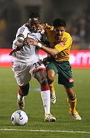 New England Revolution midfielder Sharlie Joseph fights for possession of the ball with Los Angles Galaxy midfielder Marcelo Saragosa. The New England Revolution beat the Los Angeles Galaxy at the Home Depot Center 1-0 in Carson, Calif. on April 1, 2006.