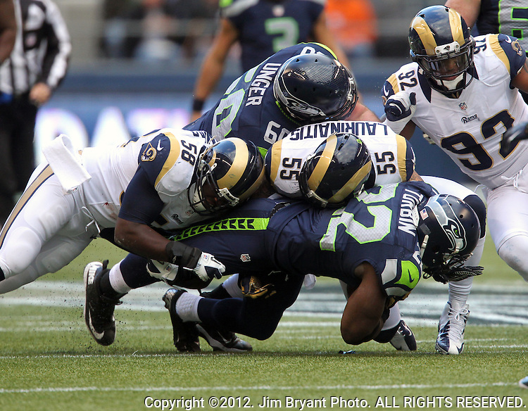 Seattle Seahawks running back Robert Turbin rushes against the St. Louis Rams at CenturyLink Field in Seattle, Washington on December 30, 2012.     © 2012. Jim Bryant Photo. All Rights Reserved.