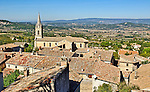 A view across the tiled rooftops of Bonnieux in the Luberon, Provence, France.