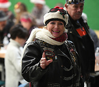 NWA Democrat-Gazette/J.T. WAMPLER Diane Storch, known as Blondie, wives to friends Sunday Dec. 1, 2019 after the 5th Annual Bikers Toy Run. The biker communities of NWA  came together to provide presents to children on Washington and Madison Counties with a toy run from north Fayetteville to Greenland High School where the toys were distributed to children by Santa.