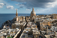 Malta, Valetta, 29 december, 2014<br /> <br /> Late morning view over Valetta, capital of the island Republic of Malta.  On the left Marsamxett Harbour. On the left St Paul's Anglican Cathedral and the round  Basilica of Our Lady of Mount Carmel.<br /> <br /> Photo Kees Metselaar