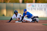 Dunedin Blue Jays second baseman Cavan Biggio (4) puts a tag on Ronald Acuna (27) during a game against the Florida Fire Frogs on April 10, 2017 at Osceola County Stadium in Kissimmee, Florida.  Florida defeated Dunedin 4-0.  (Mike Janes/Four Seam Images)
