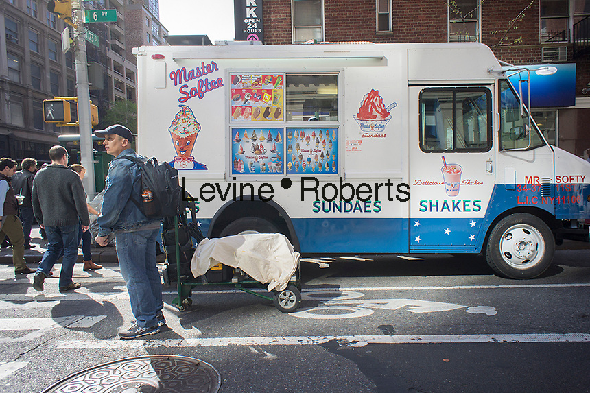 A Master Softee soft ice cream truck parked  in Chelsea in New York seen on Monday, May 5, 2014. Mister Softee is suing the Master Softee business for trademark infringement. (© Richard B. Levine)