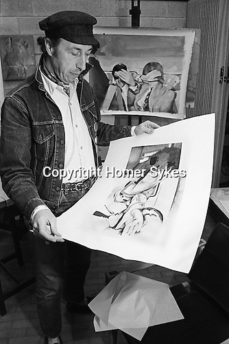 Richard Hamilton pop artist in his studio London UK 1968. Seen in studio with prints depicting Mick Jagger and Hamilton's art dealer Robert Fraser being arrested for possession of drugs. <br /> <br /> Swingeing London  1968-69<br /> Screen-print on canvas, acrylic and collage